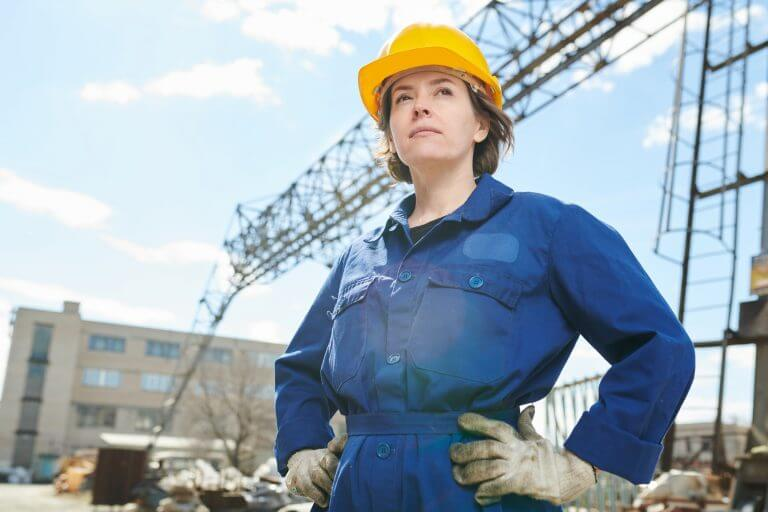 Confident Woman Posing at Construction Site