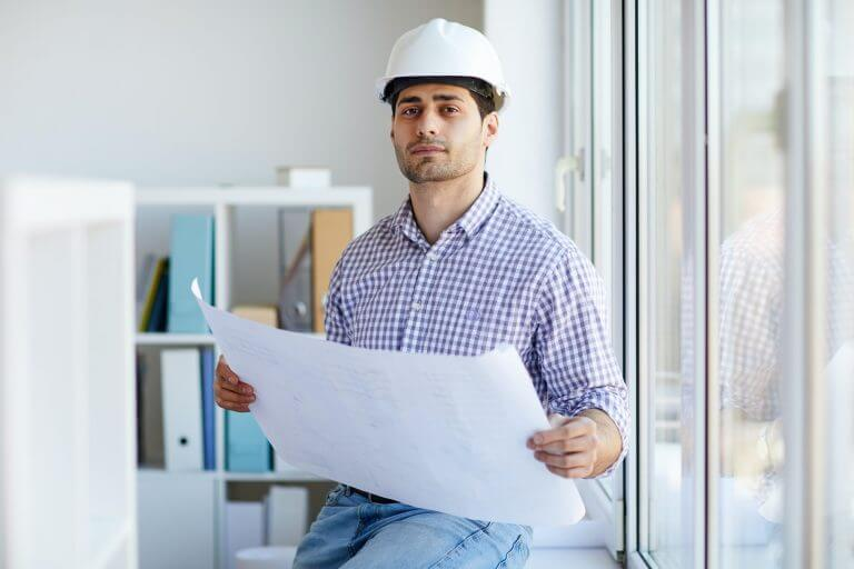 Middle-Eastern Engineer Holding Plans