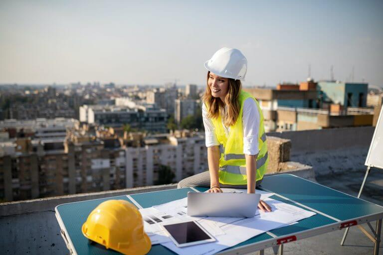 Young woman architect, construction engineer at a construction site